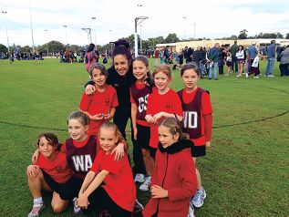 West Coast Fever player Ashleigh Brazill with a Year 3 team from West Balcatta Primary School.