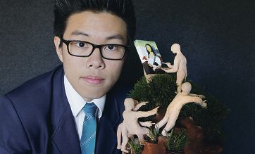 Top award winner Galvin Yap with part of his work 'Art or Rubbish ? The Artists' Struggle