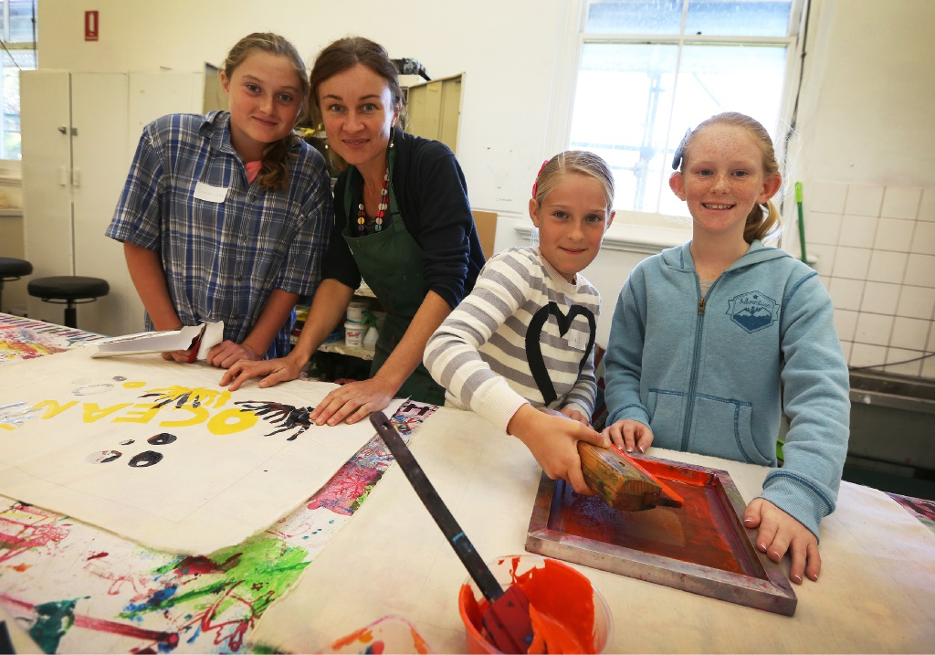 Student Emmanuella with tutor Louise Snook and students Ella-Rose and Gemma enjoying a school holiday course at the Fremantle Arts Centre last year.