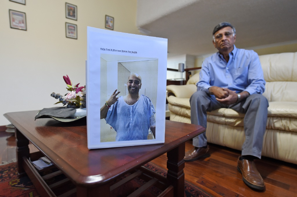 Chem Nayar with a photo of his son Sujith