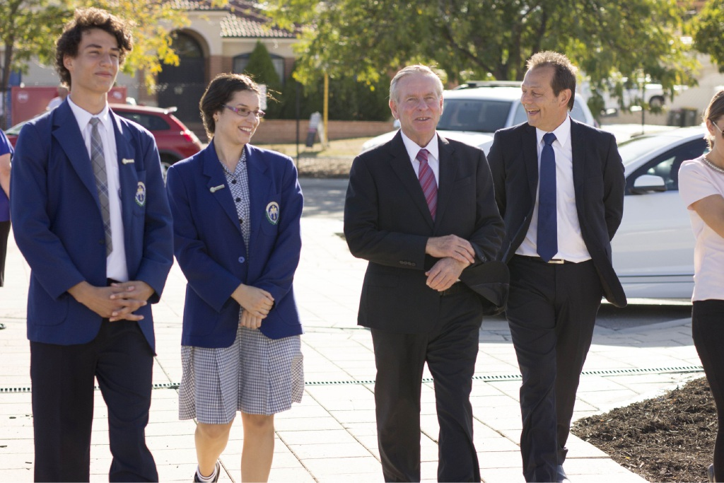 St Andrew's school headboy and headgirl and St Andrew's School Board chairman Paul Kotsoglo escort Premier Colin Barnett to the gymnasium.
