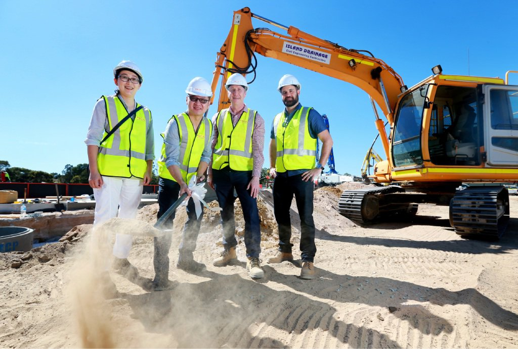 Hoi Chen, Kim Su, David Welsh and Marc Spadaccini turn the soil at the Waterhall Shopping Centre site in South Guildford.
