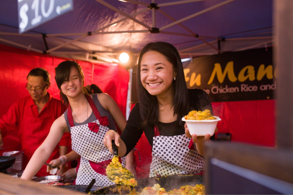 Staff at Fu Manchu Portuguese Chicken Rice in the city's Twilight Hawkers Markets. |Picture: JR Photography