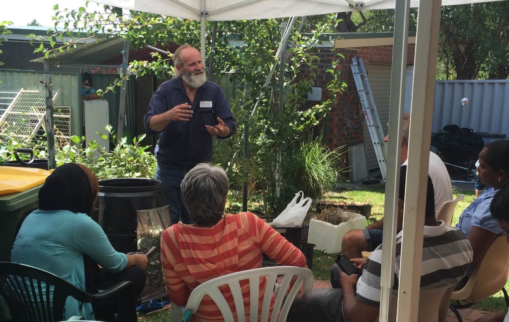 Rob Gulley takes a free worm composting workshop.