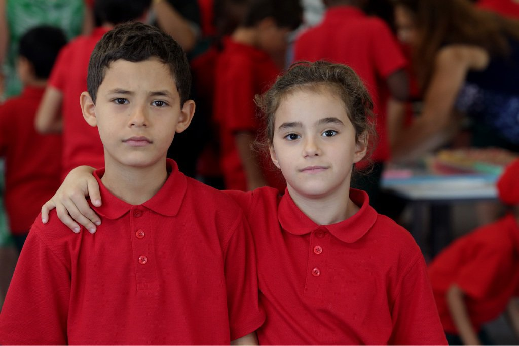 Brother and sister Mohammad and Maryam. Mohammad said he was happy in the classroom.  Picture: Martin Kennealey www.communitypix.com.au   d450132