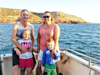 Mark and Mandy Slocombe with their children. The volunteer fireman died suddenly in March.