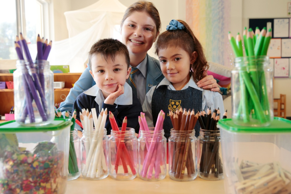Louis Collison (4), with Year 10 student Stella Scott and Bailey Terepai (4), prepare for the market bazaar fundraiser at St Hilda's. Picture: Andrew Ritchie        www.communitypix.com.au   d453291