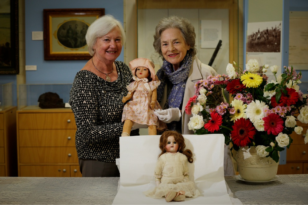 Museum convenor Val Hutch and society vice-president Lennie McCall with some dolls made in the 1920s. Picture: Andrew Ritchie        www.communitypix.com.au   d453350