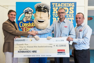 David Gribble receives a cheque from Kennards Hire state business and development manager Craig Durkee and area manager Chris Walkden.