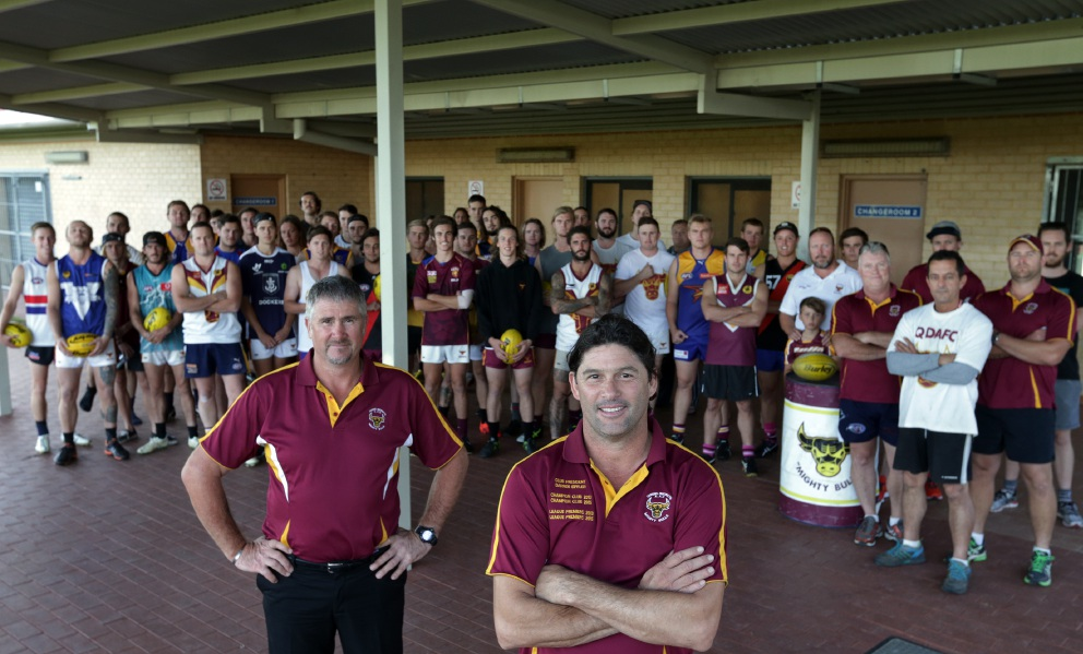 Quinns District Amateur Football Club vice president Brett Wahlert and club president Darren Eiffler with players and coaches. Picture: Martin Kennealey d453098
