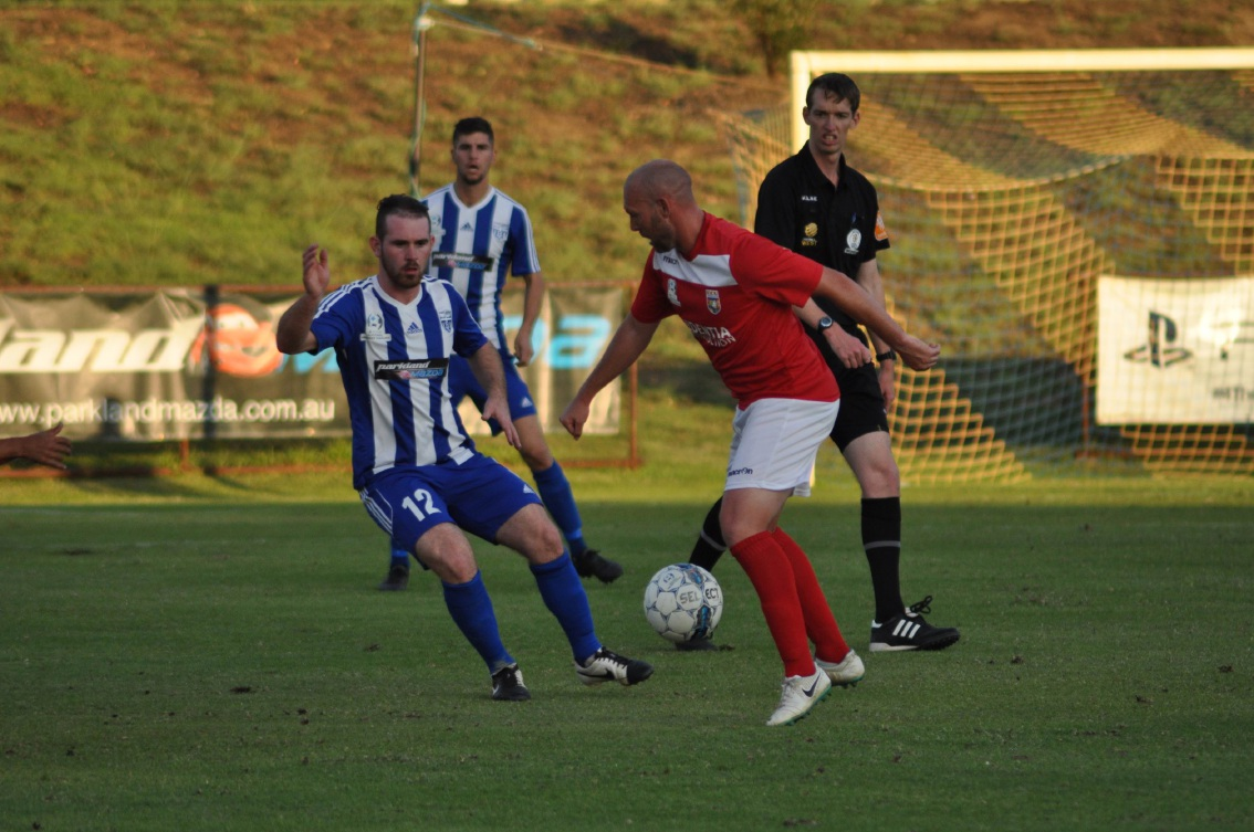 ECU midfielder Steven McGarry (right) and Floreat's Declan |Hargreaves in action.        Picture: Peter Simcox