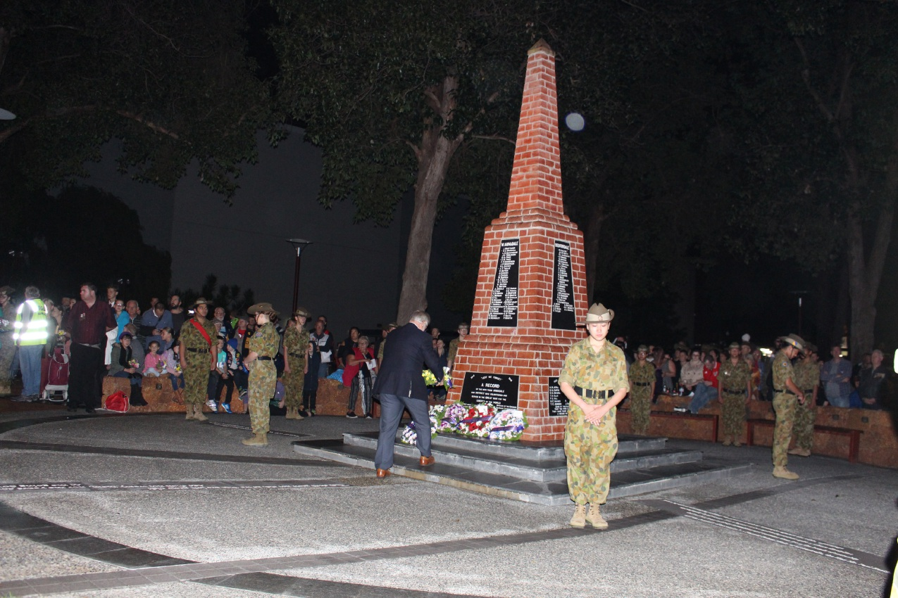 Left: Armadale army cadets guard the war memorial during the Dawn Service; Above right: Armadale RSL sub-branch president Ken Hepburn delivers his address; ARKS rugby representatives Finn Obank and Jacob Good lay a wreath. Armadale Mayor Henry Zelones lays a wreath at the memorial.