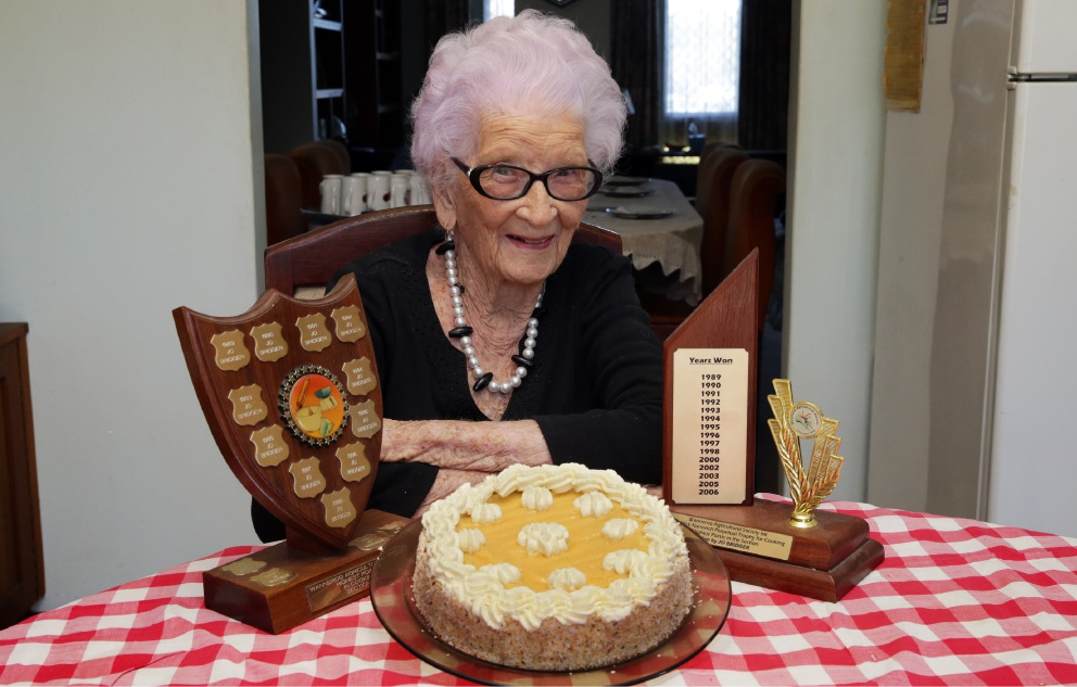 Josephine Bridger and her famous lemon butter cake. Picture: Martin Kennealey d453087