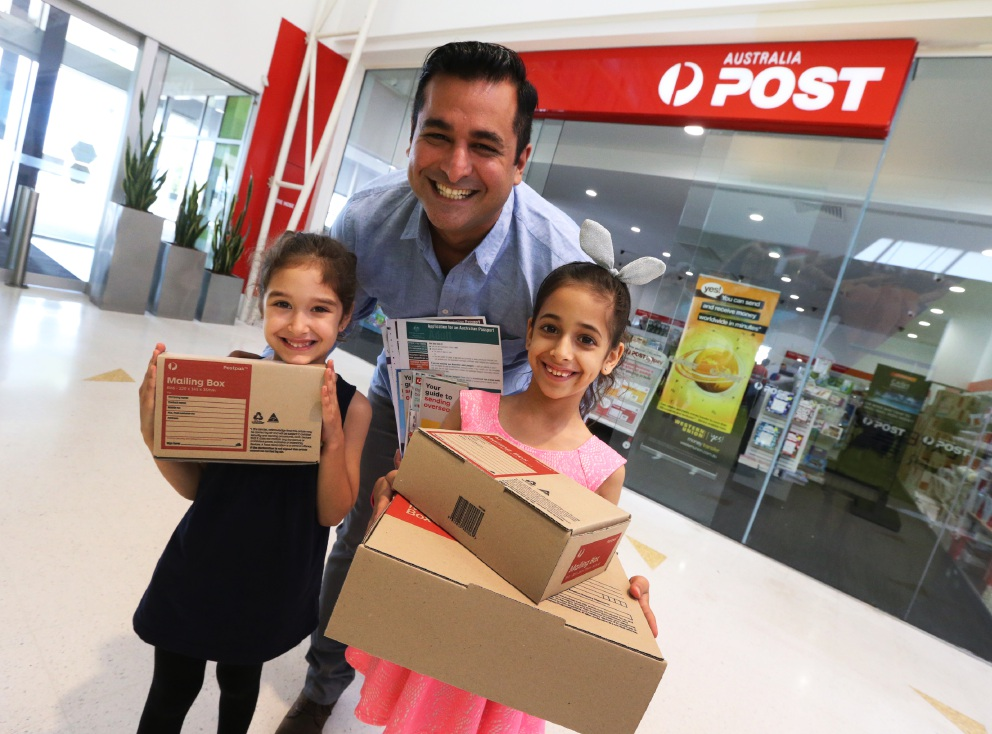 Suri, Yaz and Australia Post outlet owner M.J. Mubarakai have made a lot of customers happy now that the the store has moved back into the shopping centre. Picture: Matt Jelonek www.communitypix.com.au   d452984
