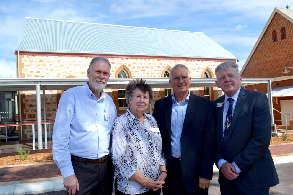 Main picture: Juniper chief executive Vaughan Harding, Northam Uniting Church elder Laura Fox and Juniper board chairman Fred Boshart with Uniting Church WA Moderator Steve Francis outside the restored Uniting Church Hall. Above: the hall before (right) and after (left) the extensive preservation work.