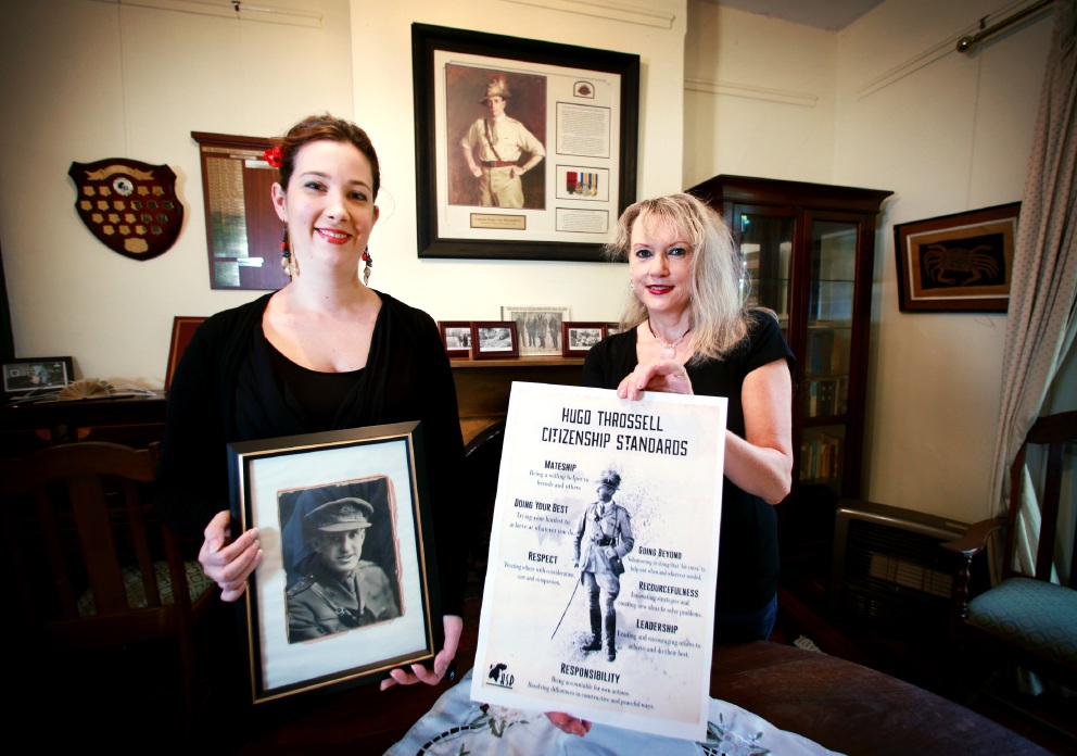 Shannon Coyle, director of the KSP Writers' Centre and award co-ordinator Valerie Everett with pictures of Victoria Cross recipient Hugo Throssell and the awards poster. Picture: David Baylis        www.communitypix.com.au   d452593