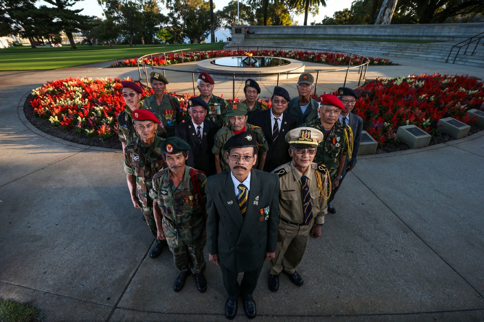 Republic of Vietnam Veterans Association of WA president Thanh Van Nguyen (front) and members at the Flame of Remembrance last week.
