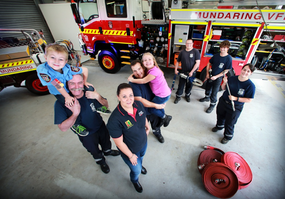 Mundaring Volunteer Fire and Rescue with Mandy Slocombe and children Keira and Deakin, who wears the firefighter's uniform made by his dad's mother Jan Slocombe. Picture: David Baylis