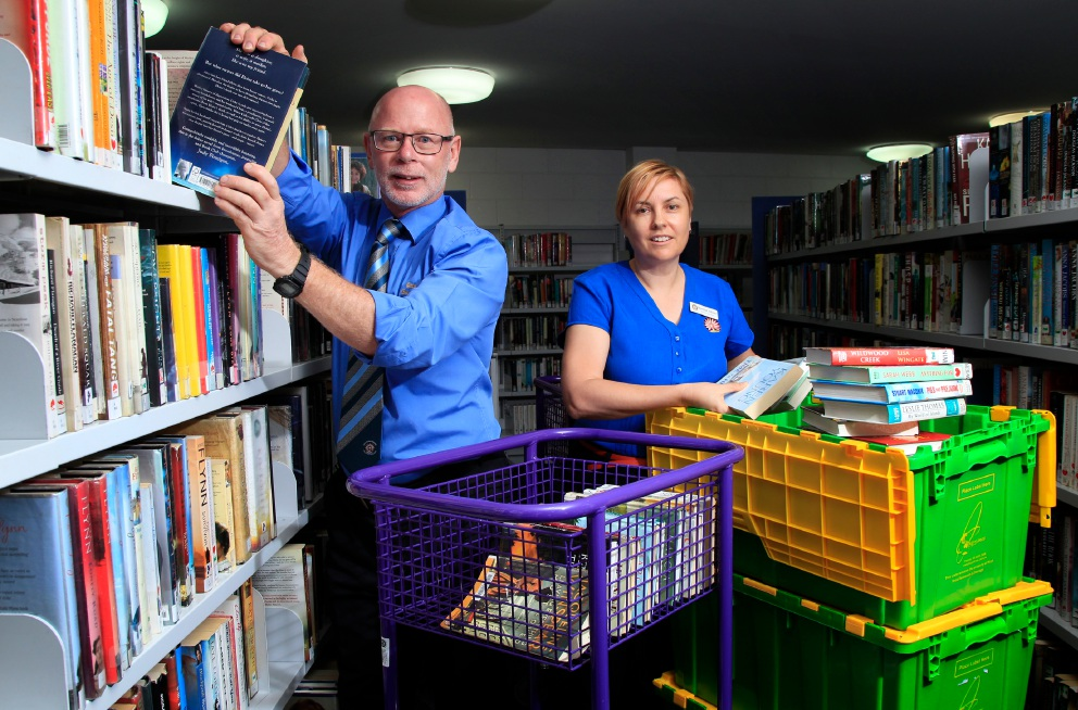 Morley Library staff Terry Fay and Karina Oliver have started to pack books for the library's move. |Picture: Marie Nirme www.communitypix.com.au   d452691
