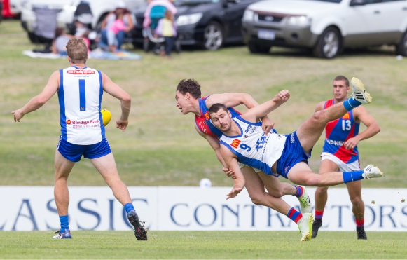 West Perth's Trent Manzone lays a tackle on East Fremantle's Jack Perham. Picture: Dan White