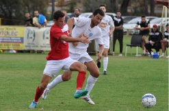 Perth SC striker Gustavo Catarcione (white) and ECU defender Andy Higgins in action. Picture: Peter Simcox.