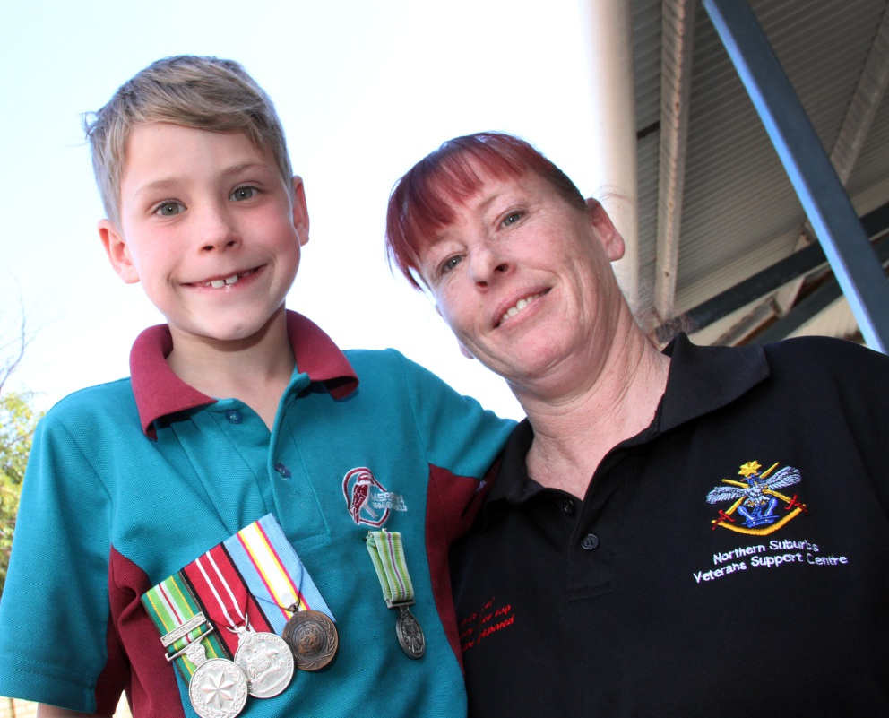 Aiden Bedford with medals from his father's service and his mother Jaei-Lee Bedford, who volunteers with the Northern Suburbs Veterans Support Centre.  Picture: Robin Kornet  d451930