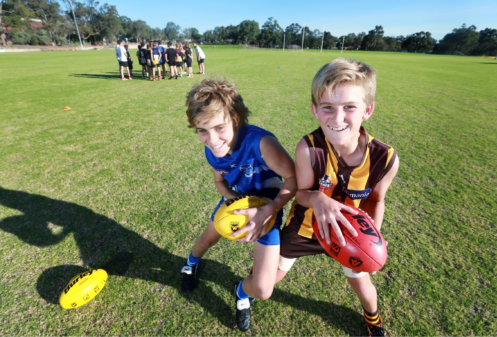 Reece Huisman and Connor McQuaid, members of the Year 8 Kalamunda and Districts Junior Football Club, at the new Kostera Oval. Picture: David Baylis d451965