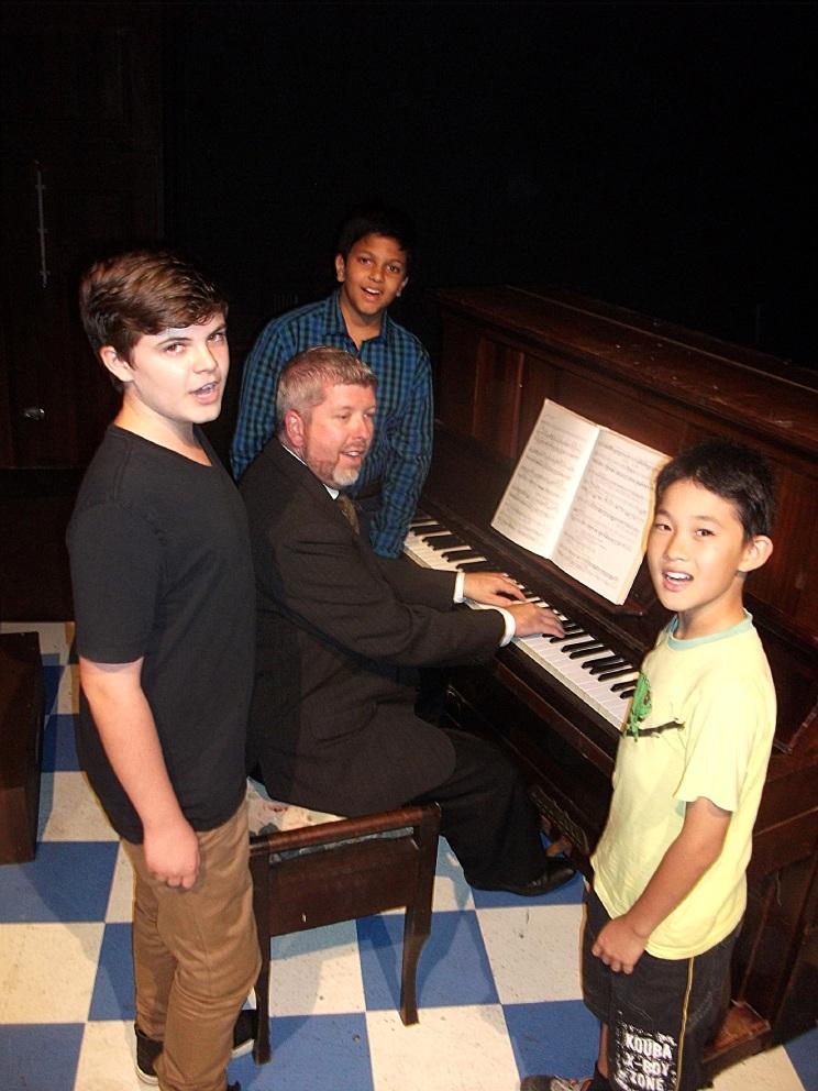 Mindarie resident Brandon Orgill, left, Surjo Mazhar Sahid and Matthew Han all play the boy soprano Charlie, who auditions for Benjamin Britten (Justin Freind) in The Habit of Art.