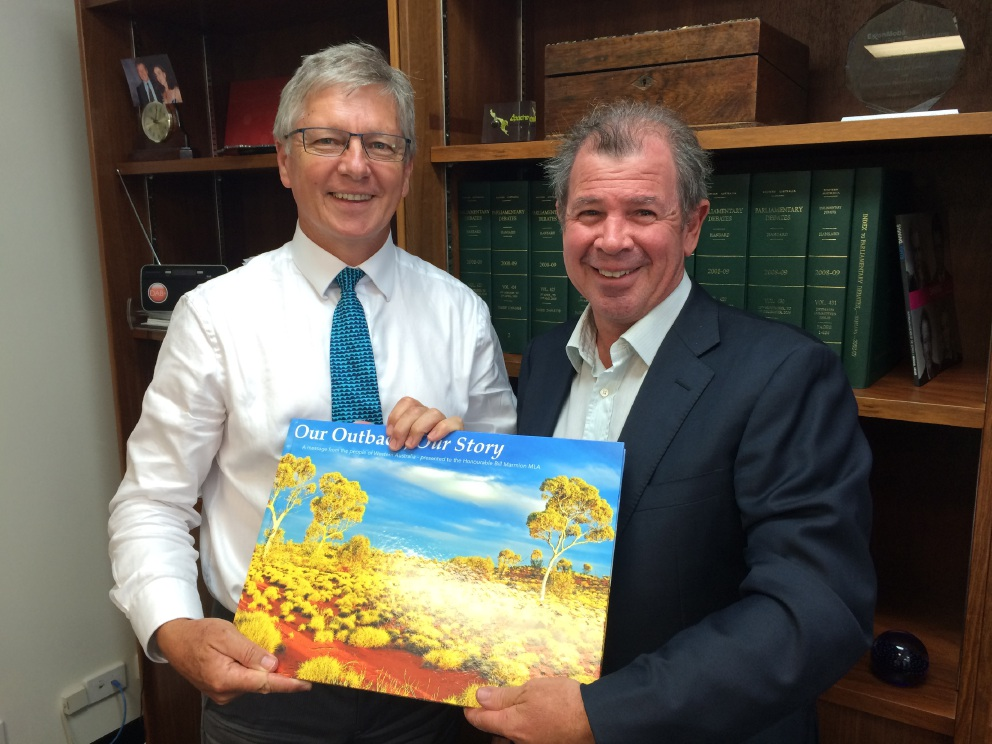 Nedlands MLA Bill Marmion and Shenton Park scientist Harley Lacy with the Partnership for the Outback photobook.