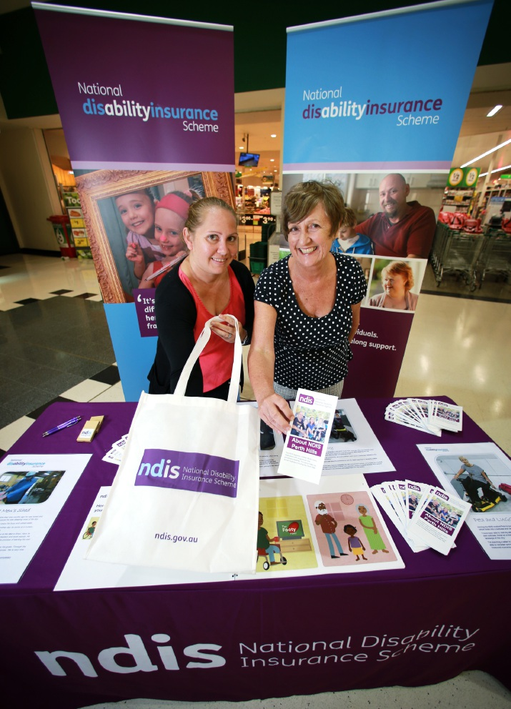 NDIS engagement business |support officer Emma Riley and |engagement outreach officer Patsy O'Grady at an information stall at Forrestfield Shopping |Centre. Picture: David Baylis           d452091