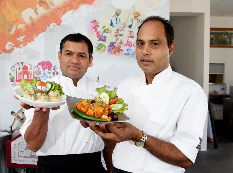 Chef Kishan Kumar and restaurant owner Ravi Sharma showing off some dishes. Picture: Marie Nirme www.communitypix.com.au   d452269