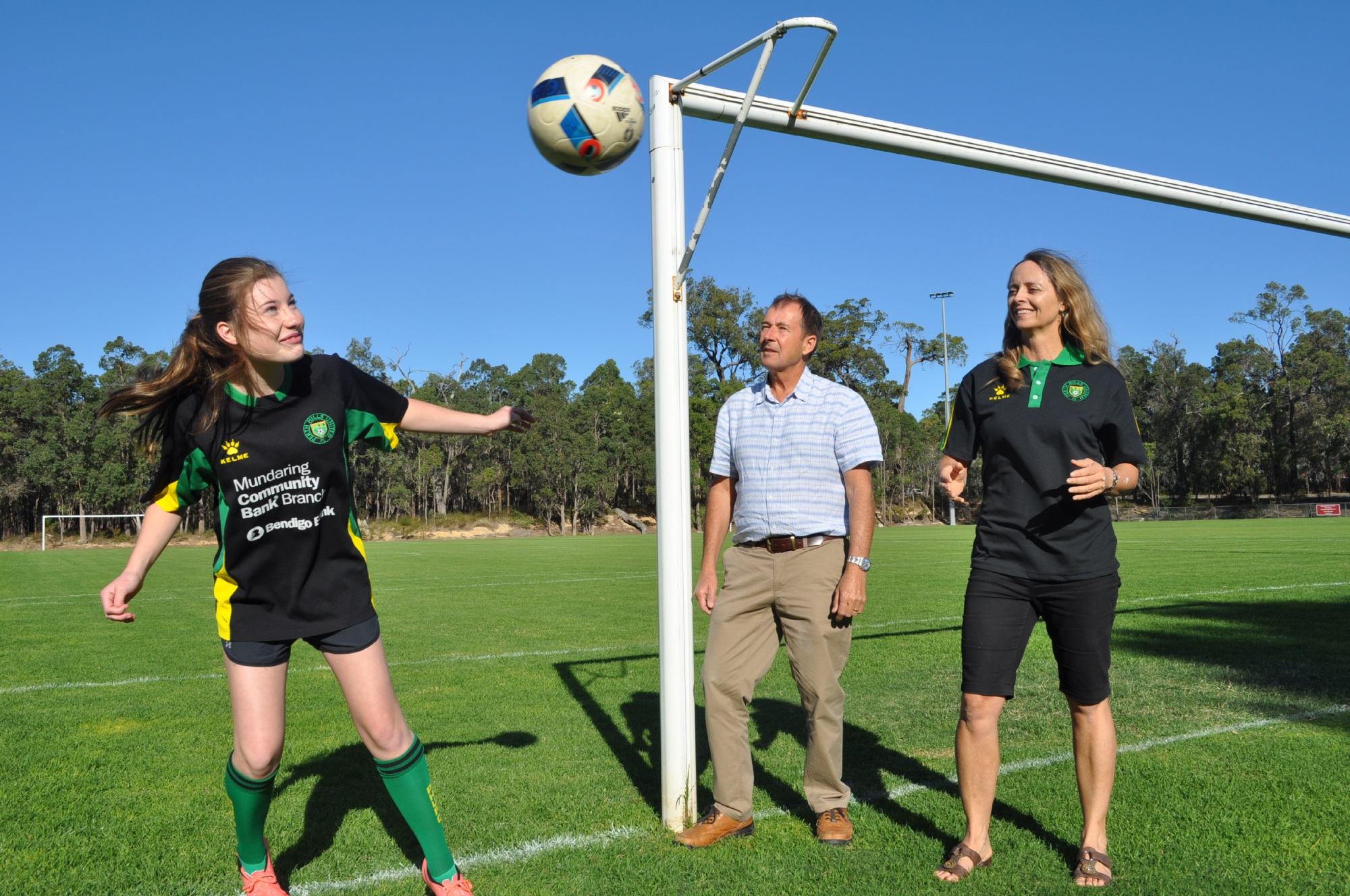 Perth Hills United Football Club members Lucy Cole and Yvonne Wintergreene with Shire President David Lavell look forward to new change rooms at Harry Riseborough Oval.