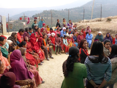Some of the Nepalese women who will benefit from Days for Girls. Inset: Interpreters |explain to the women how to use the sanitary kits.