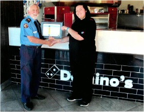 Baldivis Volunteer Bush Fire Brigade fire fighter Peter Skilton thanks Domino's Pizza Baldivis employee Ashlee Price.