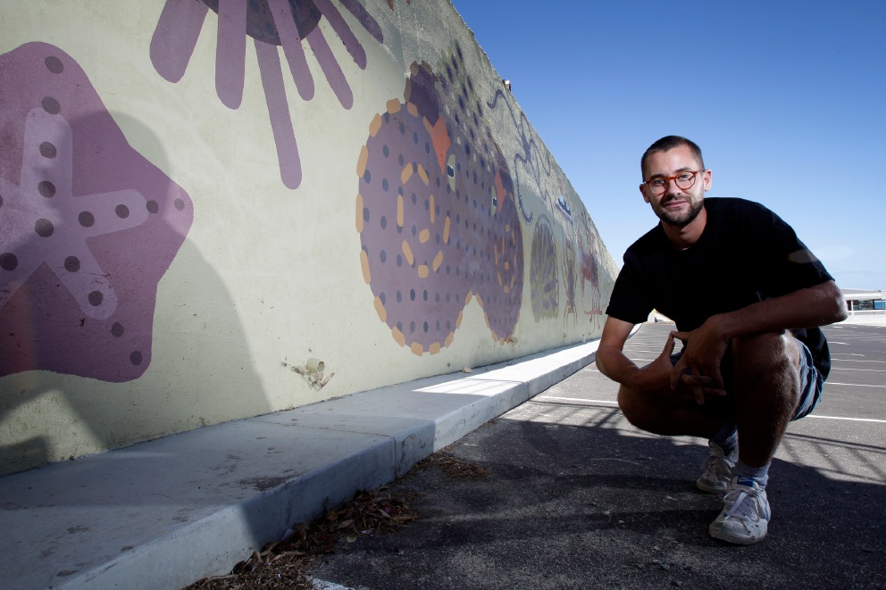 Artist Amok Island with his piece at the MAAC's new carpark. Picture: Marie Nirme d452029