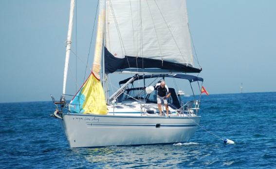 Chris Blackney on Vaya Con Dios retrieves the man overboard.