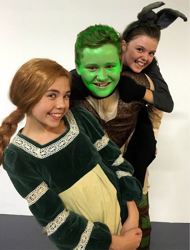 Stephanie Shaw, Ashley Garney and Midland resident Saoirse Gerrish are Princess Fiona, Shrek and Donkey in Shrek Junior – The Musical.
