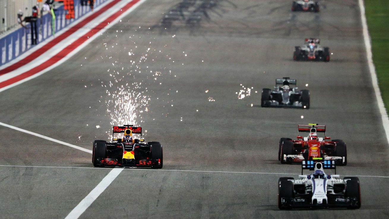 Sparks fly as Daniel Ricciardo makes a move on Raikkonen's Ferrari and the Williams of Bottas.