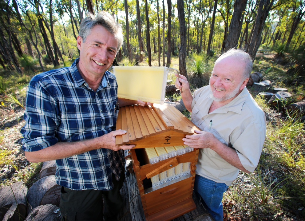 Flow Hive co-inventor Stuart Anderson with beekeeper Peter Detchon.  For more details on the demonstration, visit the Flow Hive and Beekeeping Field Day Facebook page.        Picture: David Baylis        www.communitypix.com.au   d452233