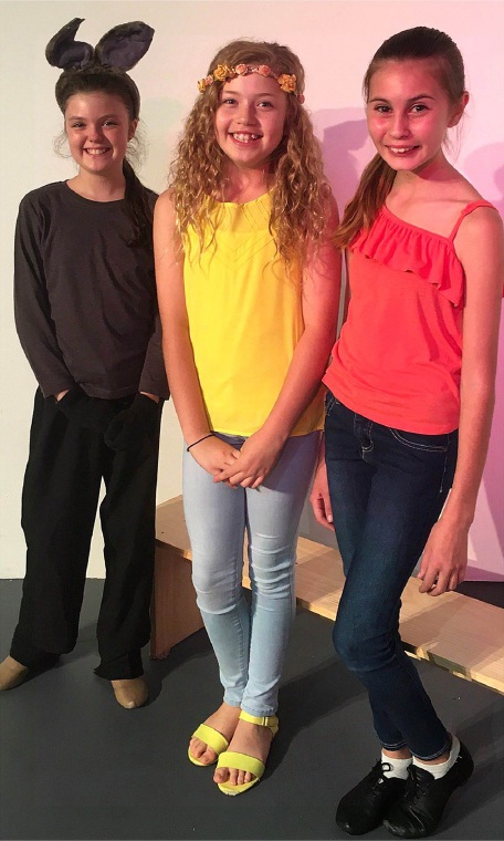 Sienna Freeman, centre, is appearing as the young Princess Fiona in Shrek Junior – The Musical with Saoirse Gerrish as Donkey and Atiya Broadwood as Pinocchio.