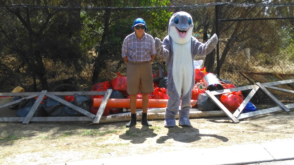 Clean-Up Peel Waterways mascot Dudley Dolphin with volunteer Tom Sewell.
