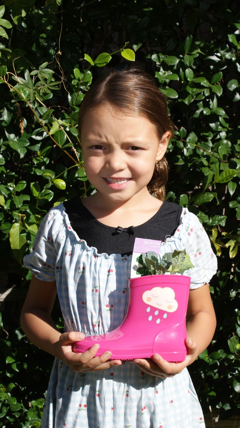 Zara Airey (7) shows the kind of boots and plants available at the market.