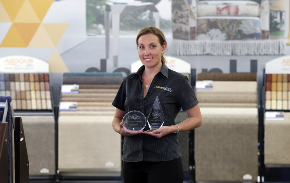Carpet Court staff member Kimberlee Meireles was recognised for her commitment to training.  Picture: Martin Kennealey        d452040