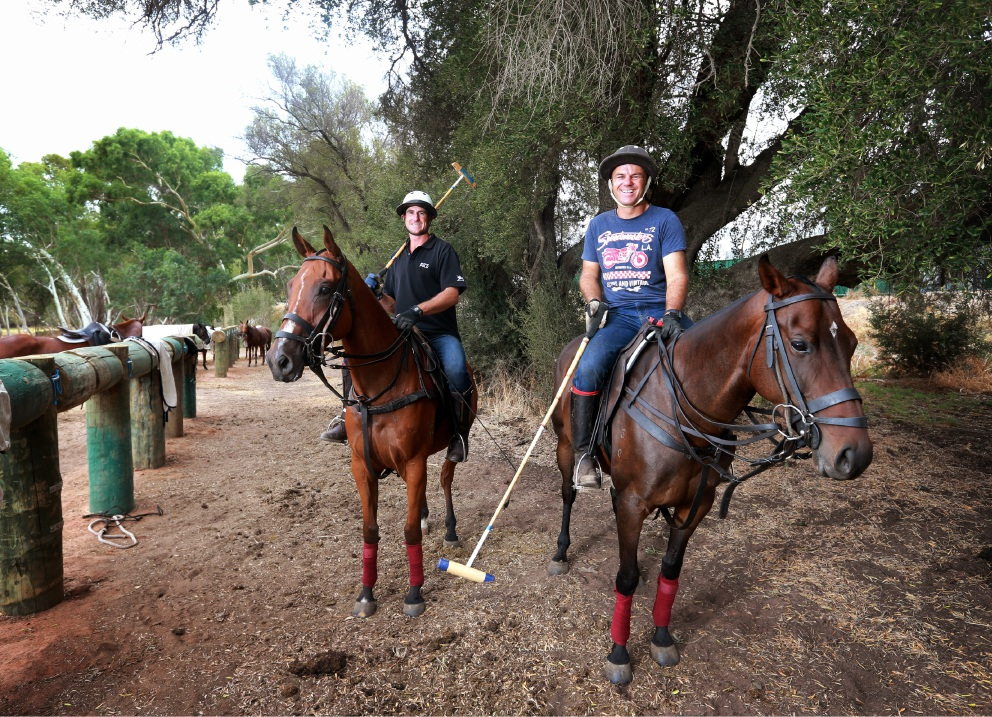 Lochie  Hunter,  on  Turkish,  and  Ru  Barlow,  on  Sarsaparilla,  preparing  for  Polo  in  the  Valley  at Duncraig  Stud.  Picture: David Baylis        www.communitypix.com.au   d451759