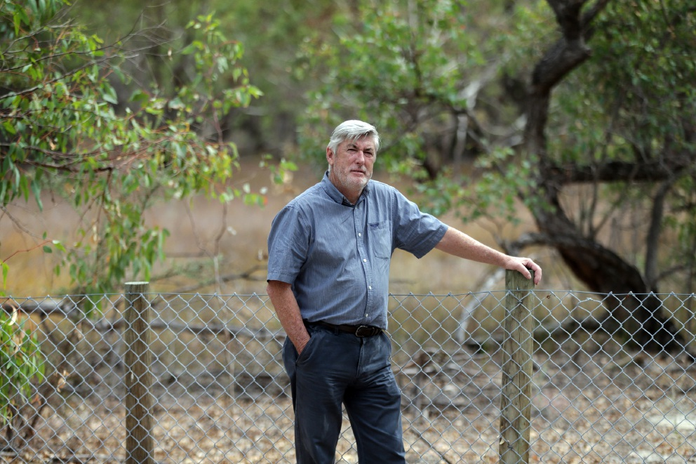 Friends of Lightning Swamp president John Williams at the fence around the swamp. Picture: Martin Kennealey