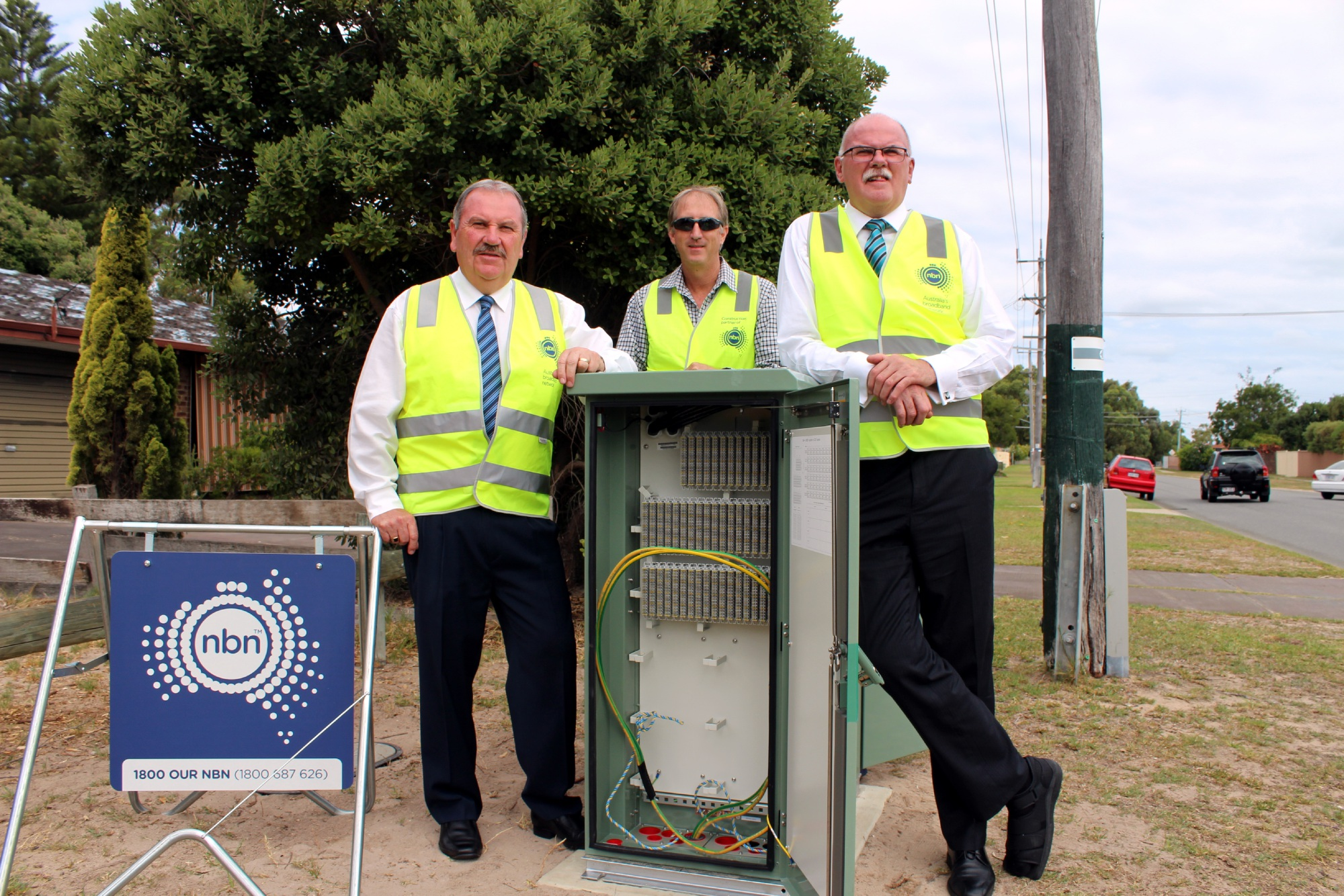 City of Rockingham Mayor Barry Sammels, Downer construction manager Daniel Meerton and City of Rockingham chief executive Andrew Hammond at one of the NBN nodes on Seabrooke Avenue, Rockingham.