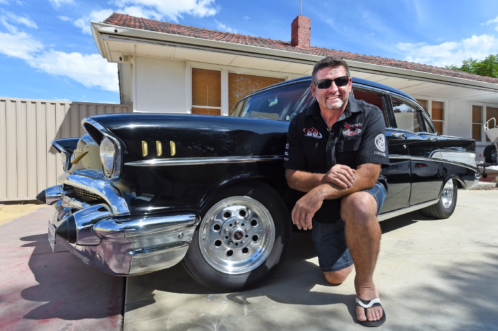 Dino Palumbo with his pride and joy, a 1957 Chevy Bel Air.