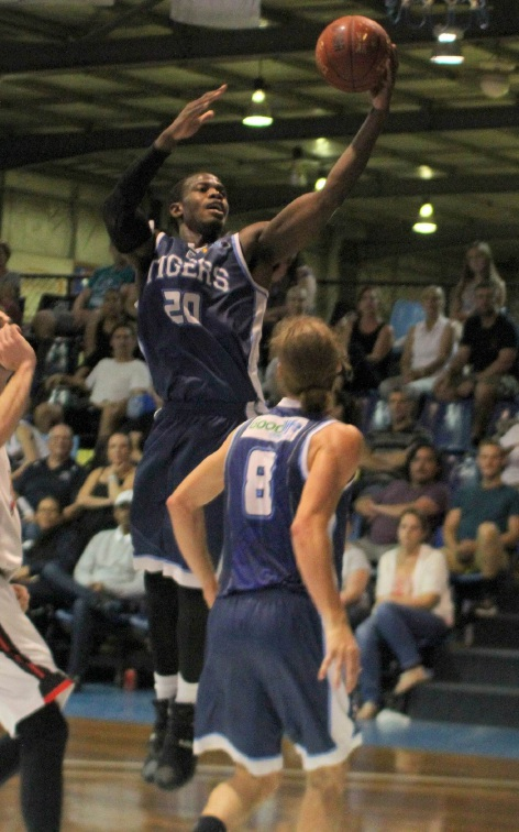 Ephrem Davis performs a lay-up for the Willetton Tigers.