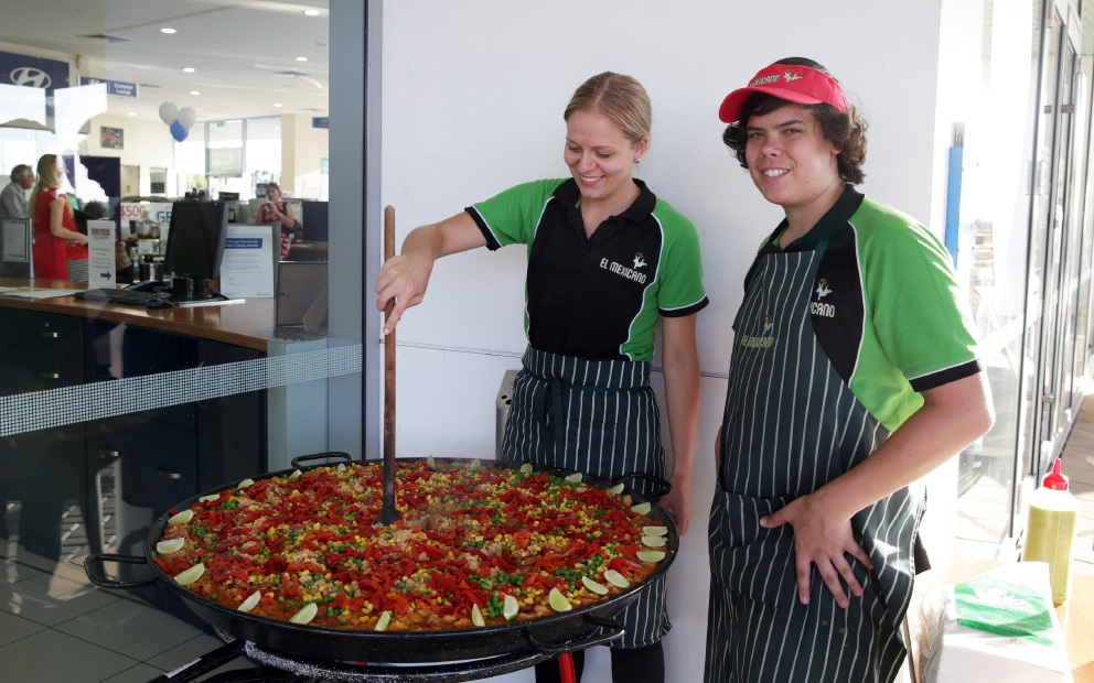 Hanna Lill and Nick Panicciari, from El Mexicano, cook up a paella. Picture: Martin Kennealey    d451045