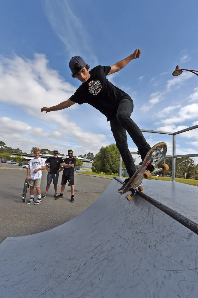 Liam James, Arbie Pattiselanno and Brad Scambler watch skater  Che Millington in action. Picture: Jon Hewson |www.communitypix.com.au   d451254
